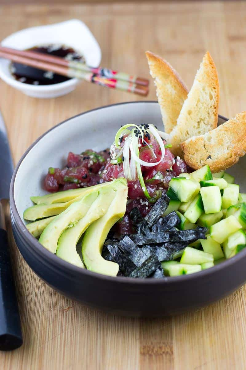 Ahi Poke Bowl with chopsticks and soy sauce bowl