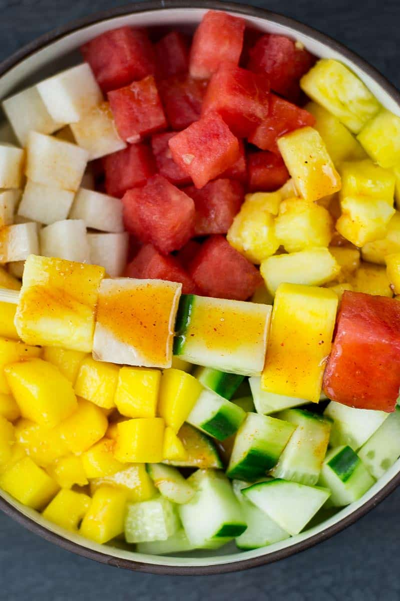 mexican fruit salad of watermelons, cucumbers, jicama and more with lime chili dressing