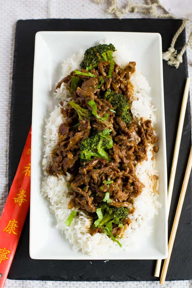 Healthy Beef and Broccoli on plate with fluffy white rice