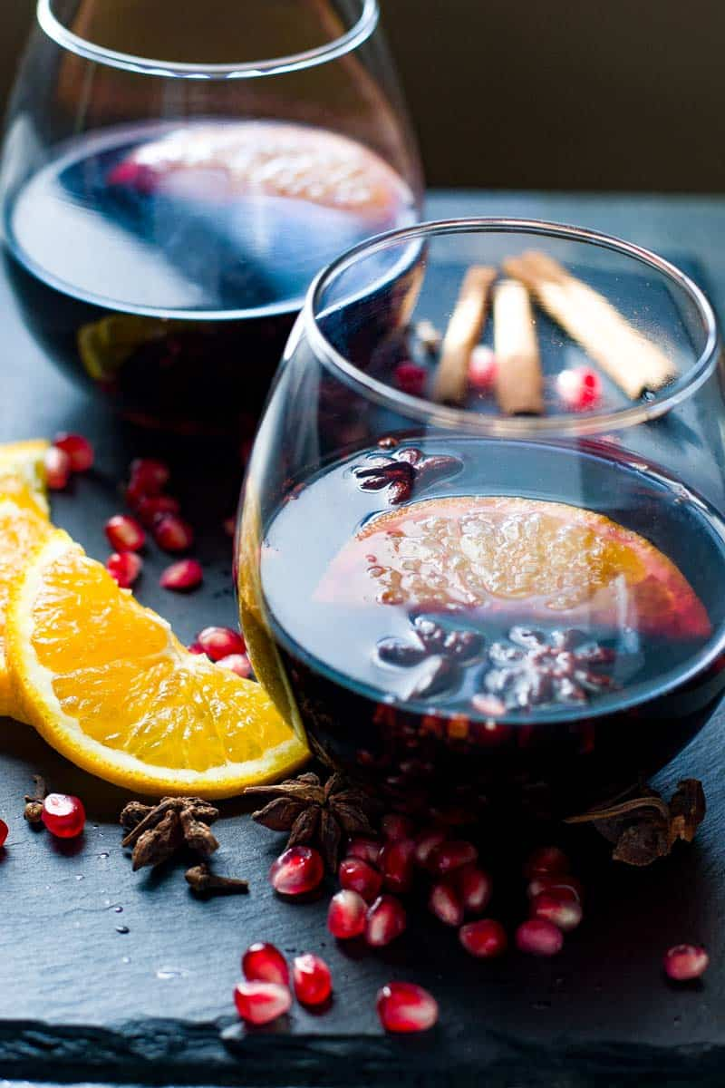 Slow Cooker Spiced Mulled Wine with Pomegranates and Oranges. Two glasses.