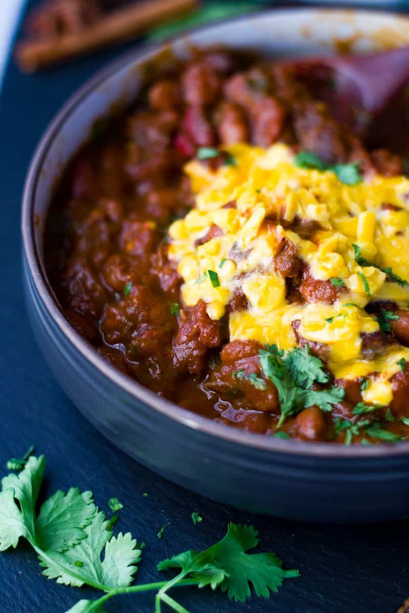 Instant Pot Chili bowl with cheddar cheese and chopped cilantro.