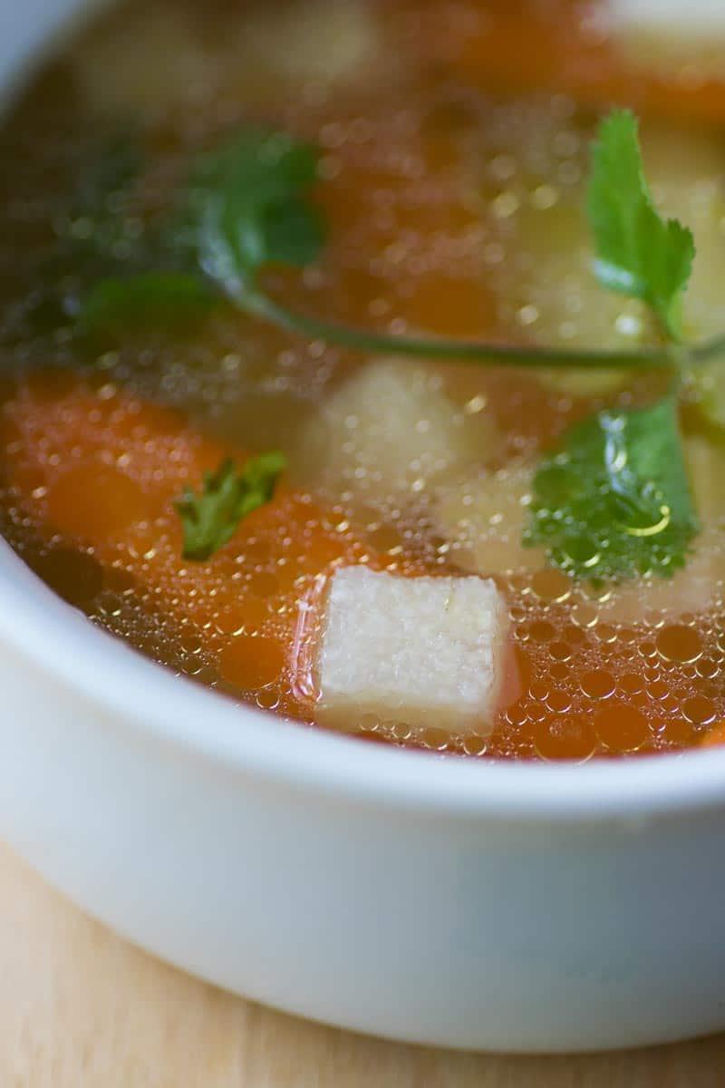 Keto Chicken Soup in white bowl